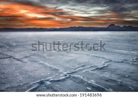 Bonneville Salt Flats under the setting sun. - stock photo