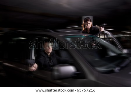 Bonnie and Clyde involved with a shootout in a parking lot - stock photo