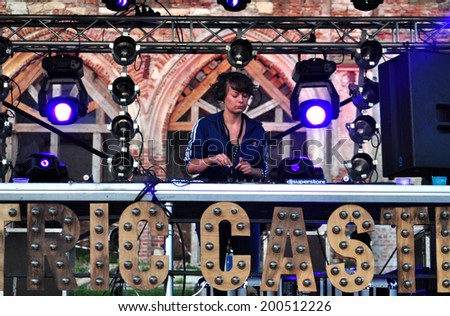 BONTIDA - JUNE 19: DJ Miss Cheeky from Hungary performs live at Electric Castle Festival at June 19, 2014 in the Banffy castle in Bontida, Romania - stock photo