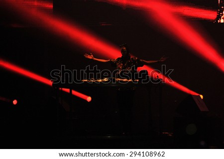 BONTIDA - JUNE 26, 2015: Fatboy Slim aka Norman Cook performs live at the main stage of the Electric Castle Festival at June 26, 2015 in the Banffy castle in Bontida, Romania - stock photo