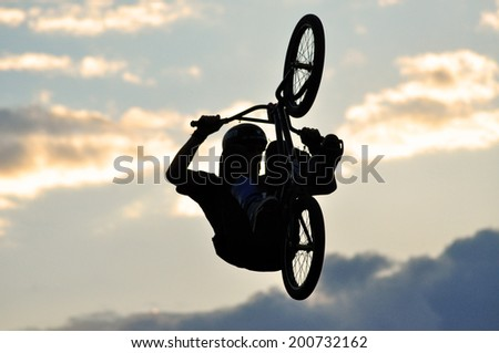 BONTIDA - JUNE 19: Unidentified BMX rider making a bike jump during the BMX Competition, at Electric Castle Festival on June 19, 2014 in the Banffy castle in Bontida, Romania - stock photo