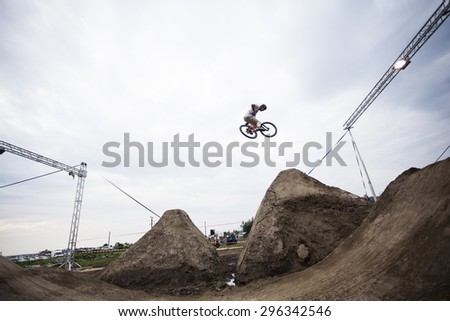 Bontida, Romania - June 27, 2015: Unidentified BMX rider making a bike jump during the BMX Competition, at Electric Castle Festival, Bontida, Romania - stock photo