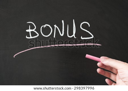 Bonus word written on the blackboard using chalk - stock photo