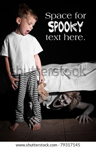 Boogie Man under the Bed Scaring a Young Child with Text Space Above - stock photo