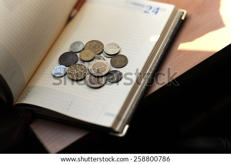 book and coins - stock photo