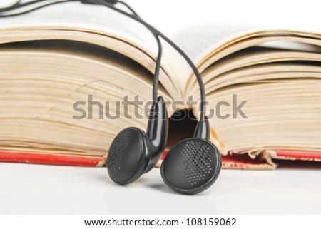 Book and earphone - stock photo