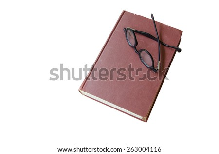 book and glasses isolated on a white background - stock photo