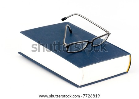 book and glasses isolated on white