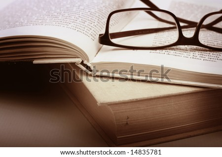 Book and Glasses. Vintage style - stock photo