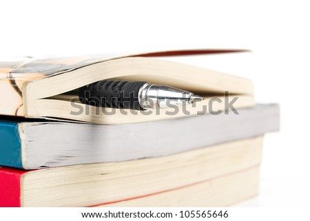 Book and pen - stock photo