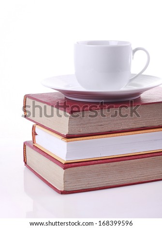 book and red coffee on white background