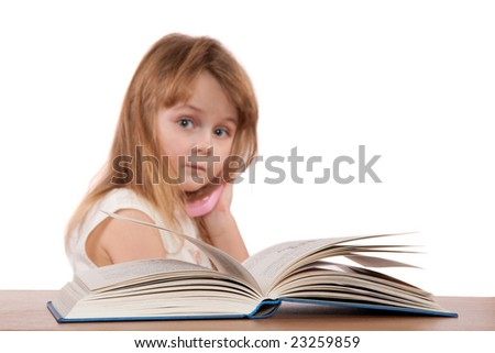 Book and young girl slightly blurred in background