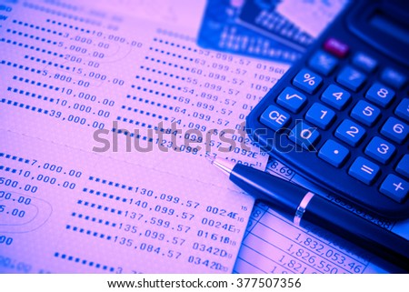 Book bank, credit cards, the calculator, a ball pen. Business finance concept. filter red and blue effect style picture. - stock photo