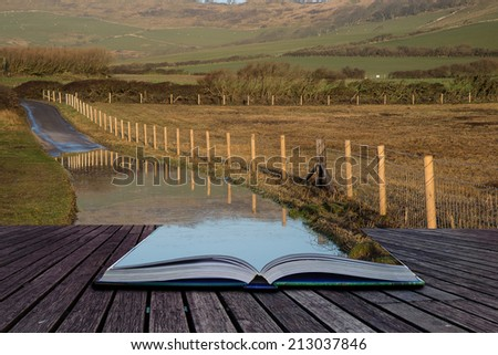 Book concept Flooded country lane farm landscape - stock photo