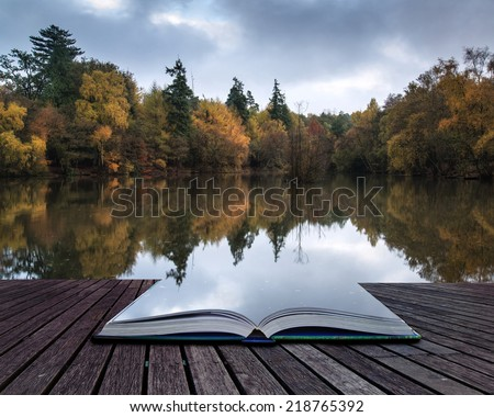 Book concept Stunning vibrant Autumn woodland reflected in still lake water landscape - stock photo