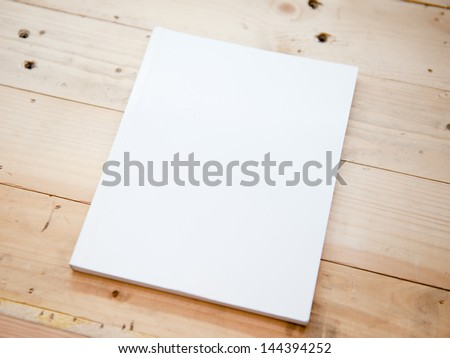 book cover white on wood table