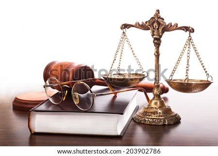 Book, glasses, antique scales, judges gavel on the table - stock photo
