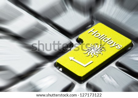 Book holidays button on the computer keyboard - stock photo
