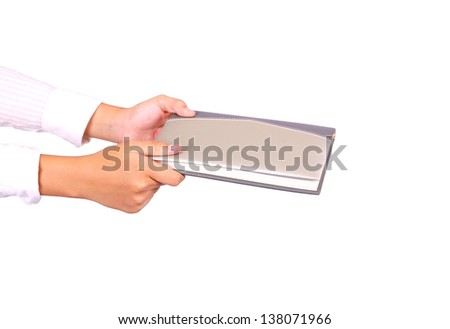 Book in hand with clipping path on white background - stock photo