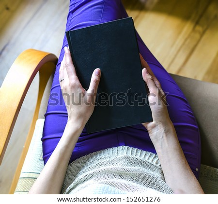 Book in hands - stock photo
