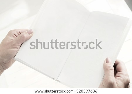 book in woman hand close up - stock photo