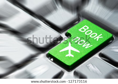 Book now button on the computer keyboard - stock photo