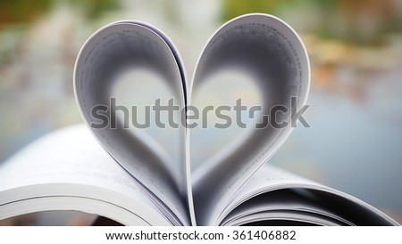 Book of love. Love books, Love reading, Love Story, Heart shape from pages of book for love concept. - stock photo