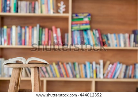book on chair in the library