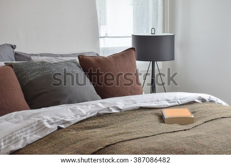Book on rustic style bedding  - stock photo