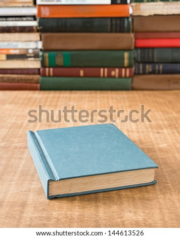 Book on the table in shallow focus. - stock photo