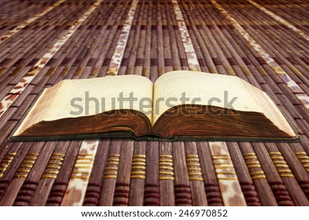book on the table in shallow focus - stock photo