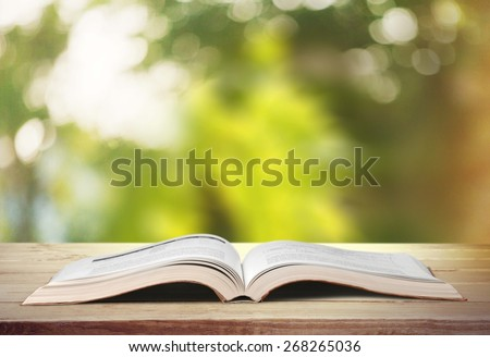 Book, open, studying. - stock photo