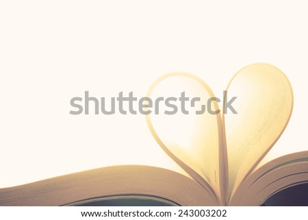 Book page in heart shape concept love , valentine day - stock photo