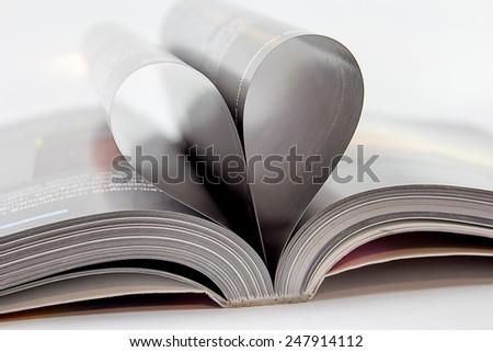 book pages folded into a heart shape Close-up abstract. - stock photo