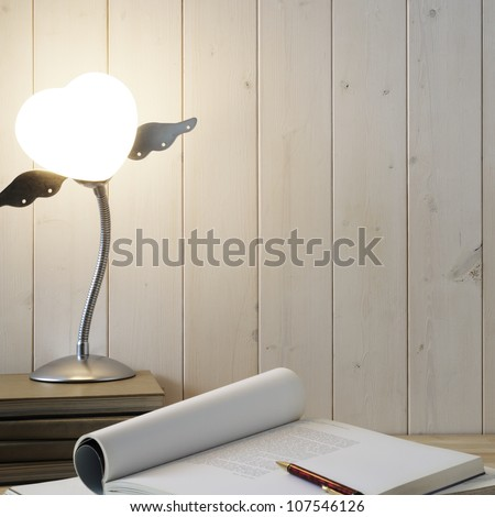 Book,pen and lamp on wooden desk - stock photo