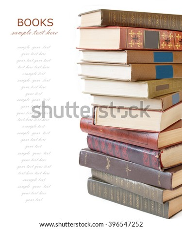 Book pile isolated on white background with sample text - stock photo