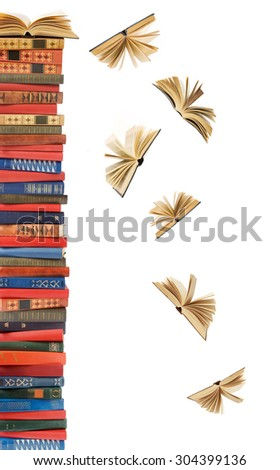 Book pile with open books flying away isolated on white background. Education concept - stock photo