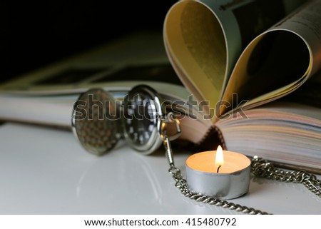 book pocket watch candles - stock photo