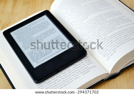 Book reader and an old fashioned book - stock photo