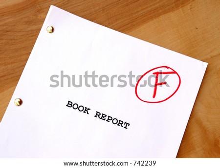 Book Report F on Desk - stock photo