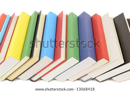 Book row : leaning row of colorful books isolated on white background.