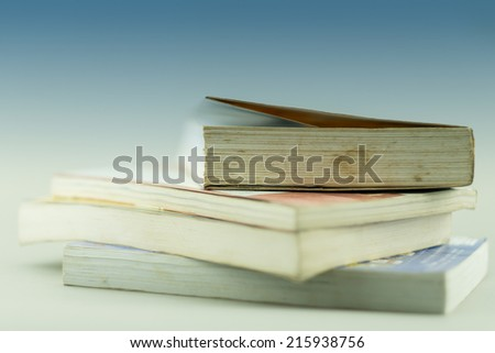 book stack isolated on the clear background - stock photo