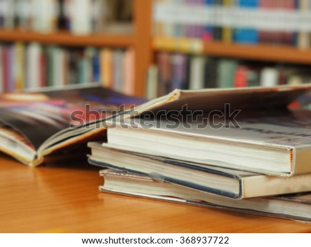 book stack on desk  in library room education zone with blurred background