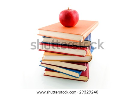 Book stack with an apple isolated on white background - stock photo