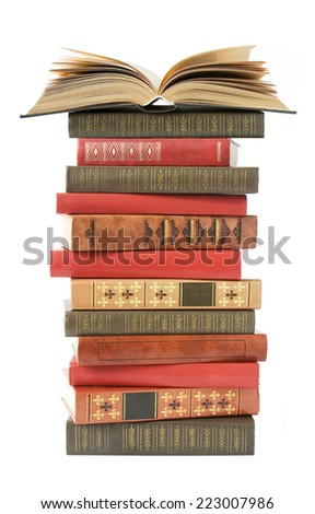 Book stack with open book on top isolated on white background - stock photo