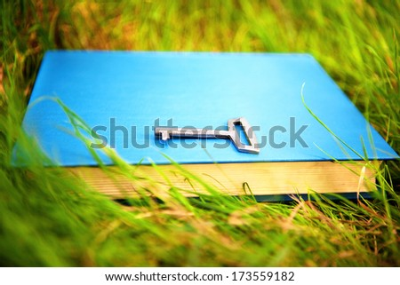 book with a key - stock photo