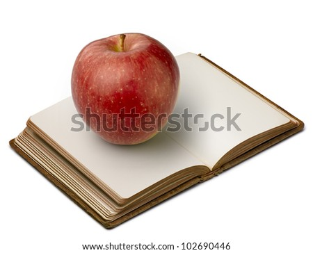 Book with apple (clipping path ) on white background - stock photo