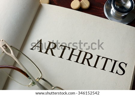 Book with diagnosis arthritis. Medical concept.