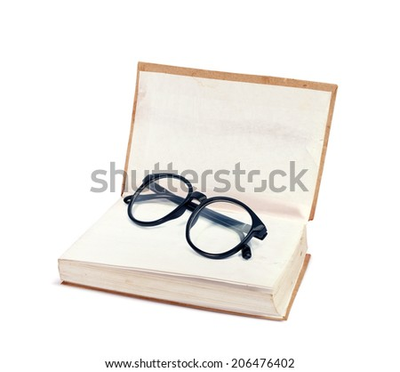 book with glasses  isolated on white background - stock photo