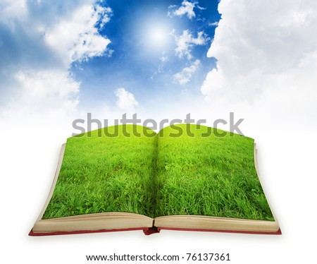 book with green landscape on pages. Magic book concept